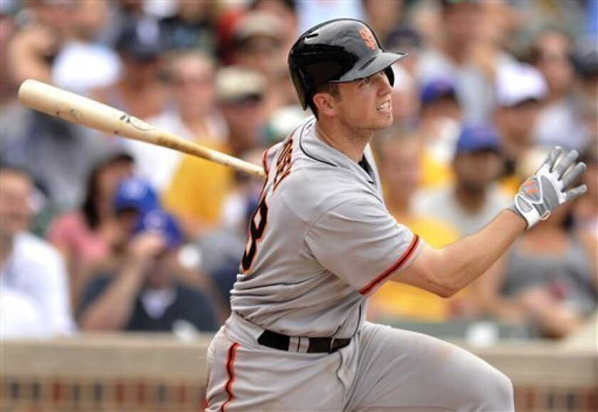 San Francisco Giants' Buster Posey watches his RBI-single in the eighth inning during a baseball game against the Chicago Cubs in Chicago, Friday, Aug. 31, 2012. Chicago won 6-4. (AP Photo/Paul Beaty)