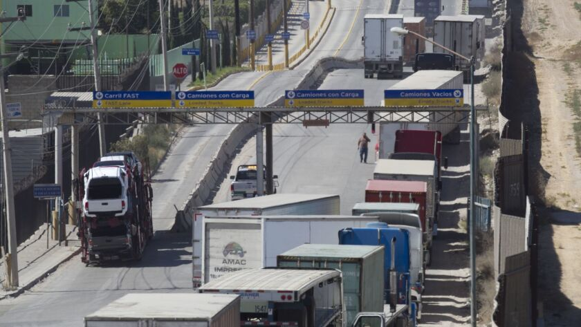 Trucks in Mexico approach the Otay Mesa Port of Entry.