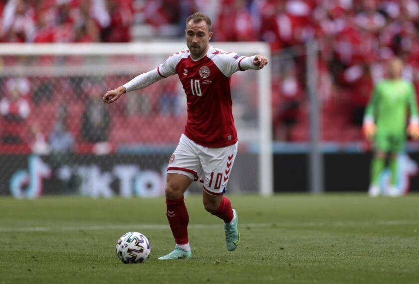 FILE - In this file photo dated Saturday, June 12, 2021, Denmark's Christian Eriksen controls the ball during the Euro 2020 soccer championship group B match against Finland at Parken stadium in Copenhagen, Denmark. Christian Eriksen has been discharged from the hospital nearly a week after collapsing on the field during a Euro 2020 soccer match, according to a statement from Danish soccer federation Friday June 18, 2021. (Wolfgang Rattay/Pool via AP)