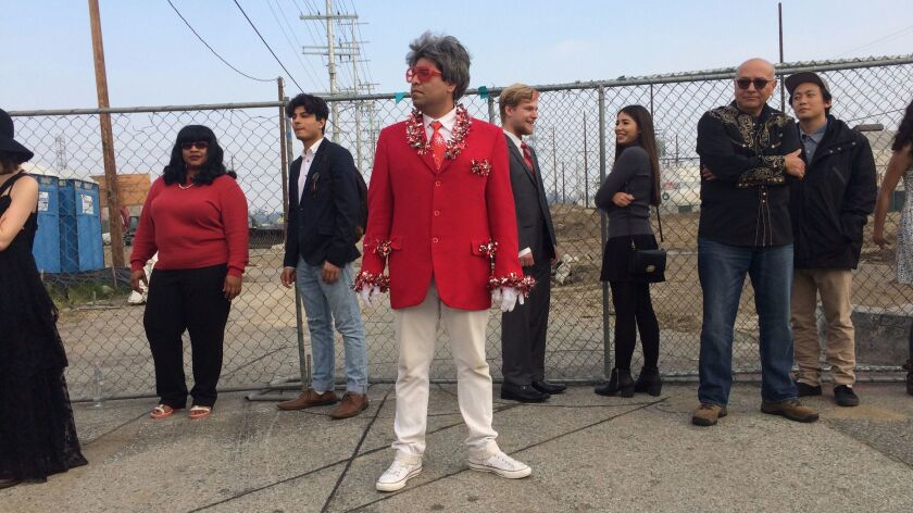 """Chris Velasco, in the foreground, dresses up as """"Barry,"""" a holiday-loving character"""