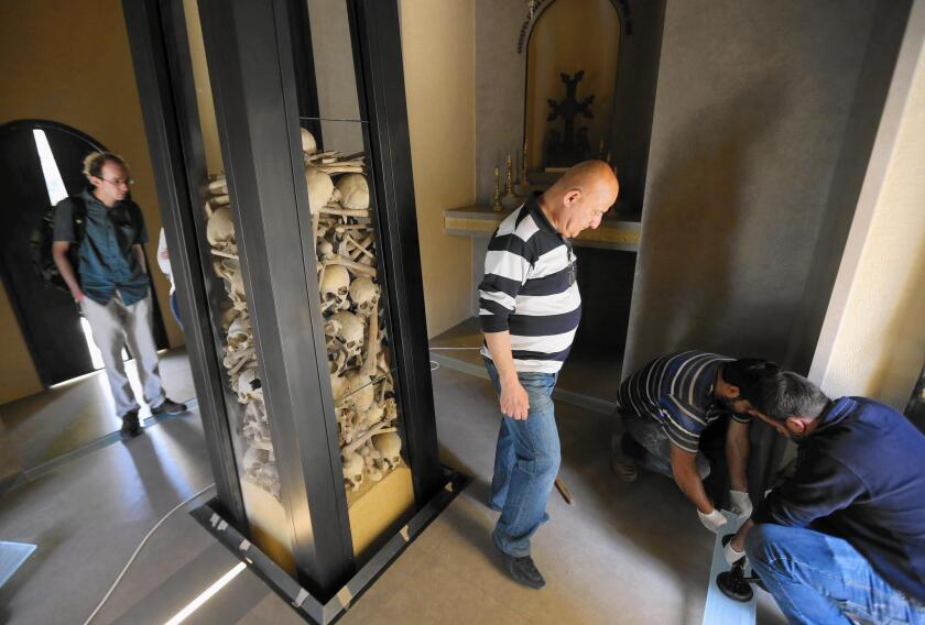 Visitors view the remains of Armenians killed under the Ottoman Empire, displayed at Saint Stephanos Church in Lebanon. The church is under renovation in preparation for the 100th anniversary of the genocide.