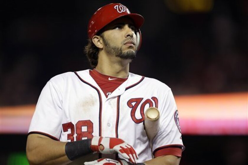 Washington Nationals Michael Morse reacts while batting during the ninth inning of a baseball game against the Milwaukee Brewers at Nationals Park in Washington, Friday, Sept. 21, 2012. The Brewers won 4-2. (AP Photo/Jacquelyn Martin)