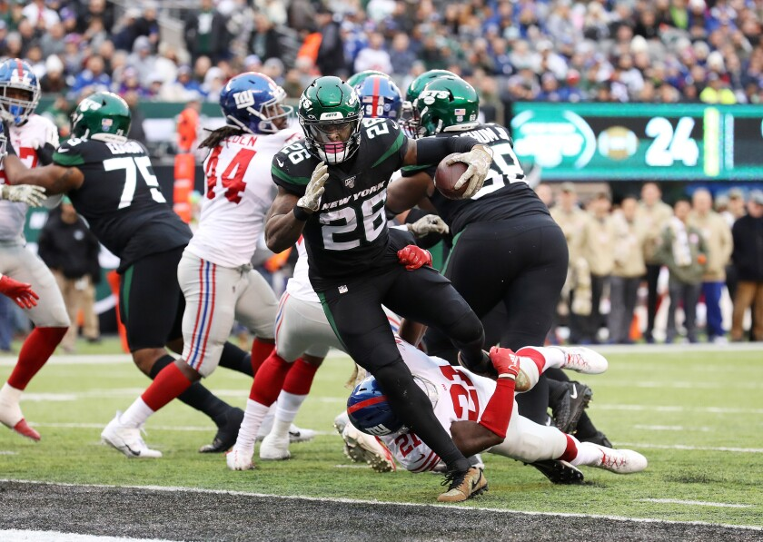 New York Jets running back Le'Veon Bell runs for a touchdown against the New York Giants.