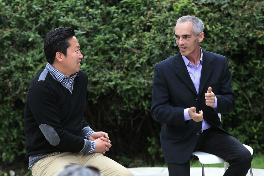 Los Angeles City Council District 13 candidates Mitch O'Farrell and John Choi greet each other before a debate May 5.
