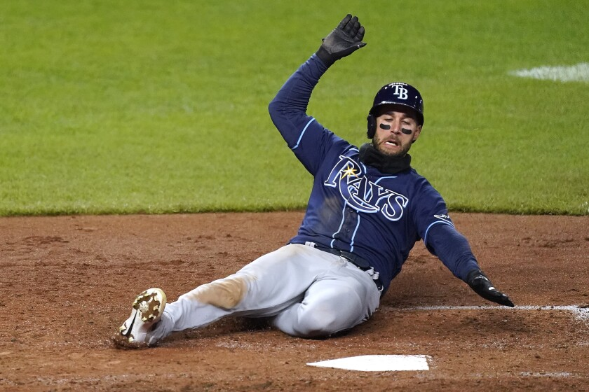 Tampa Bay Rays' Kevin Kiermaier slides home to score on a triple by Willy Adames during the fifth inning of a baseball game against the Kansas City Royals Tuesday, April 20, 2021, in Kansas City, Mo. (AP Photo/Charlie Riedel)