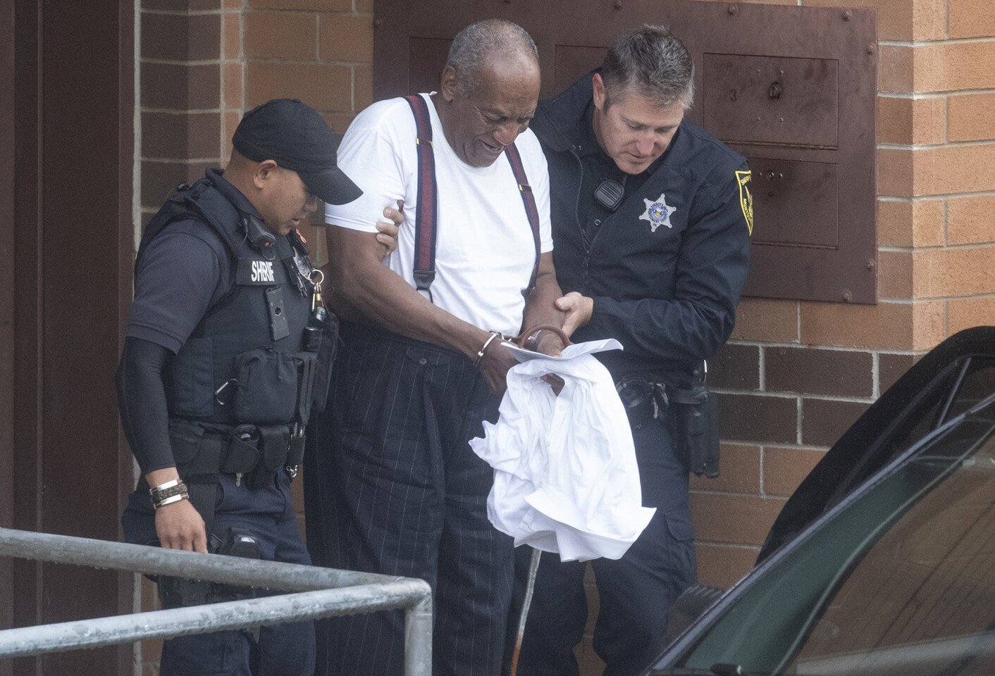 Actor and comedian Bill Cosby is led away in handcuffs from Montgomery County Correctional Facility in Norristown, Pa. after being sentenced to three to 10 years in prison for assaulting a woman at his home in 2004.