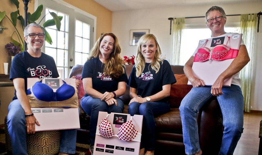 Marianne Masterson, left, Jennifer Carey, Anna Chimowicz and Cathy Orchard with some of the whimsical award plaques for The Boob Ride, a charity biking event on April 16 that raises money for breast cancer charities. Carey and Chimowicz started the ride seven years ago in honor of their moms, who have battled breast cancer, and Masterson and Orchard, seen here at their Bonsall home, are raising money for the cause. Masterson's six older sisters have all battled breast cancer.