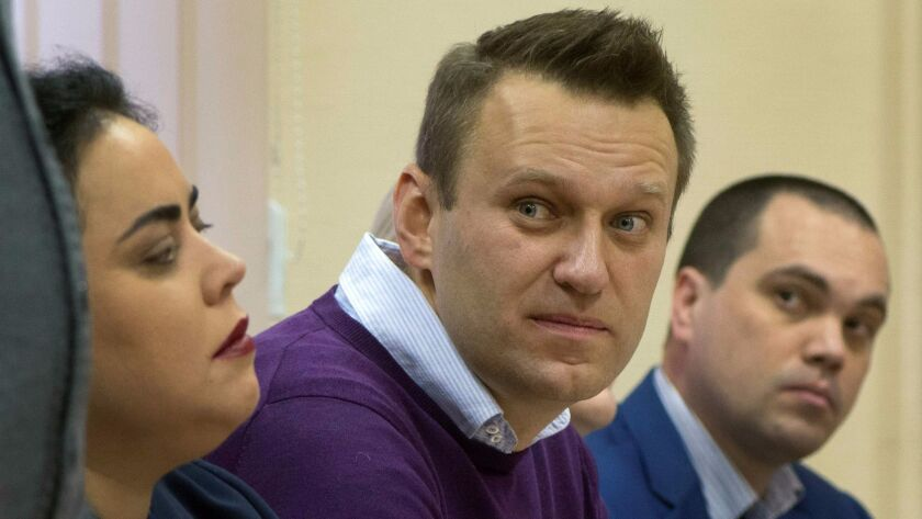Russian opposition leader Alexei Navalny listens during a Dec. 5 court hearing in Kirov.