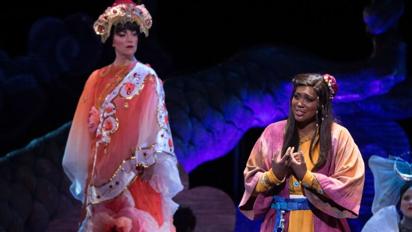 "Sopranos Lise Lindstrom and Angel Joy Blue, who play Turandot and Liu, in a scene from San Diego Opera's ""Turandot,"" now playing at the San Diego Civic Theatre."