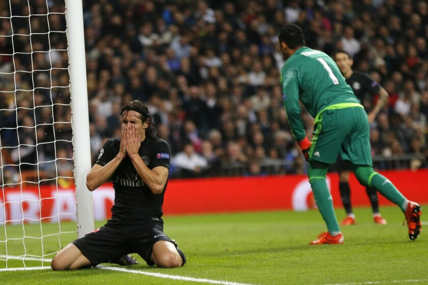 PSG's Edinson Cavani  reacts after missing to score during their Group stage of Champions League Group A soccer match against Real Madrid at the Santiago Bernabeu stadium in Madrid, Spain, Tuesday, Nov.3, 2015. (AP Photo/Daniel Ochoa de Olza)
