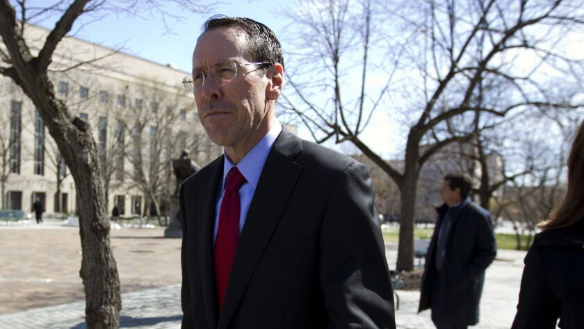 AT&T Inc. Chief Executive Randall Stephenson leaves the federal courthouse in Washington in March.