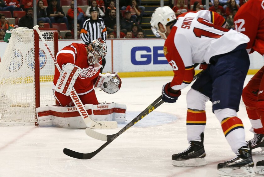 Detroit Red Wings goalie Petr Mrazek (34) stops a Florida Panthers right wing Reilly Smith (18) shot in the third period of an NHL hockey game, Monday, Feb. 8, 2016 in Detroit. (AP Photo/Paul Sancya)