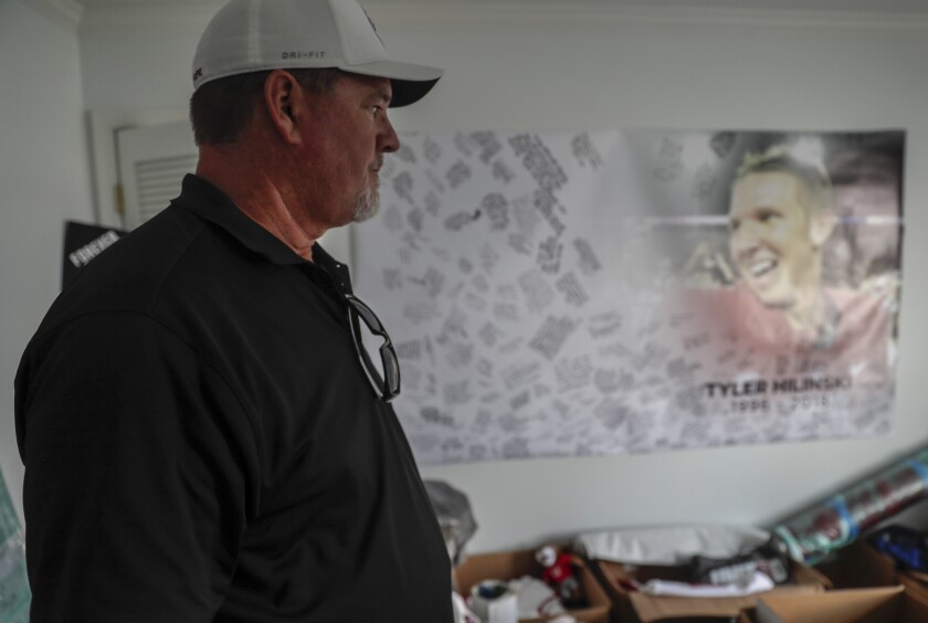 Mark Hilinski looks in on a bedroom where memorabilia of his son Tyler, a star quarterback at Washington State University is stored.
