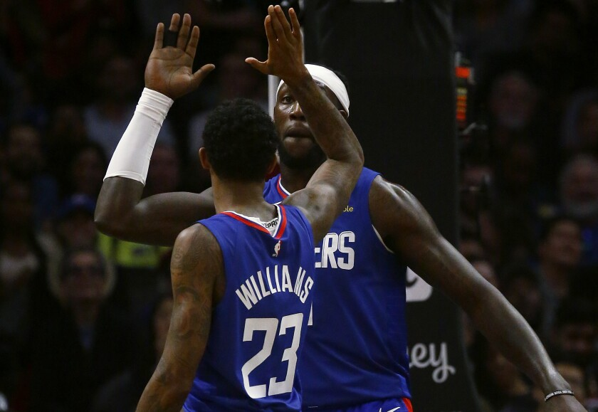 Clippers forward Montrezl Harrell is congratulated by teammate Lou Williams.