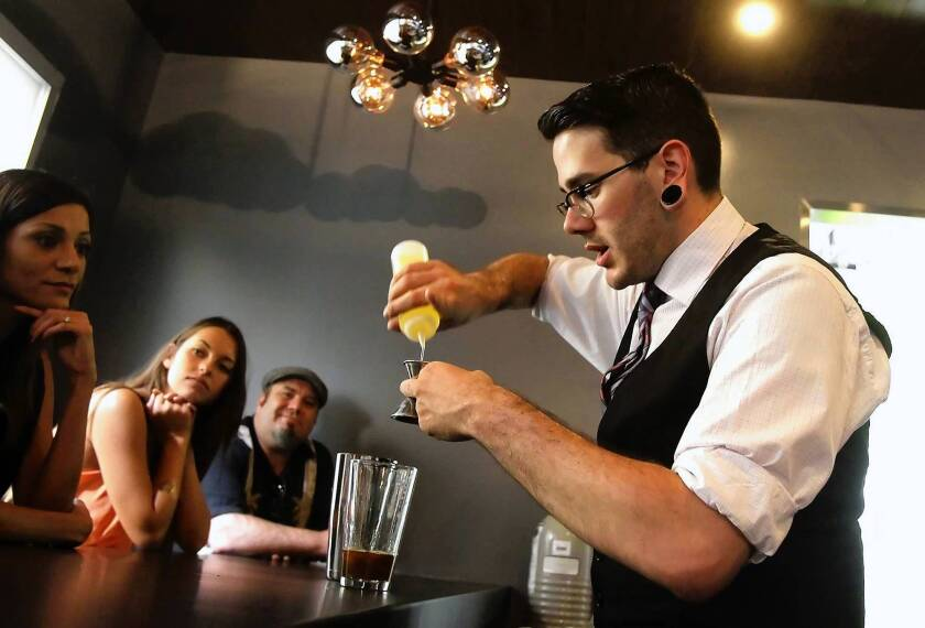 Like mixing a vintage cocktail, Truman Seversen prepares a special coffee based drink for guests in the new Theorem coffee bar at the Portola Coffee Lab at the OC Mart Mix in Costa Mesa.