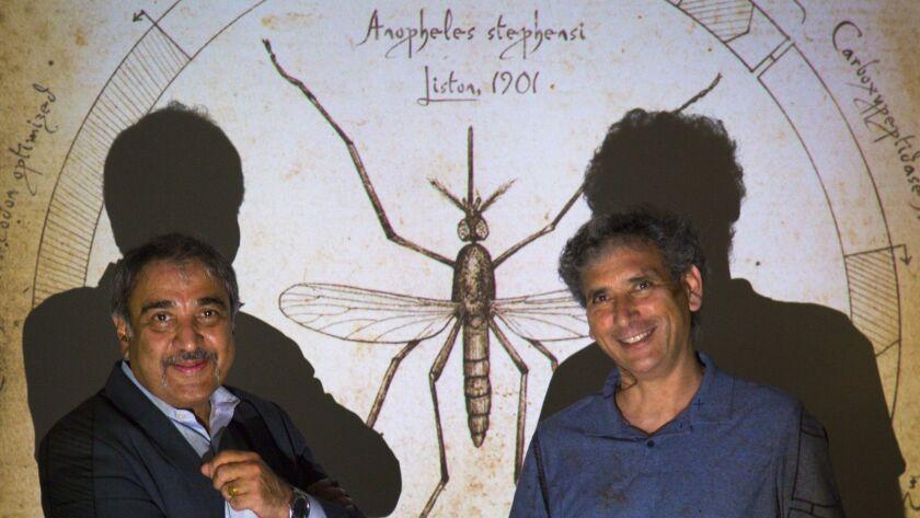 UC San Diego chancellor Pradeep Khosla and genetics professor Ethan Bier.