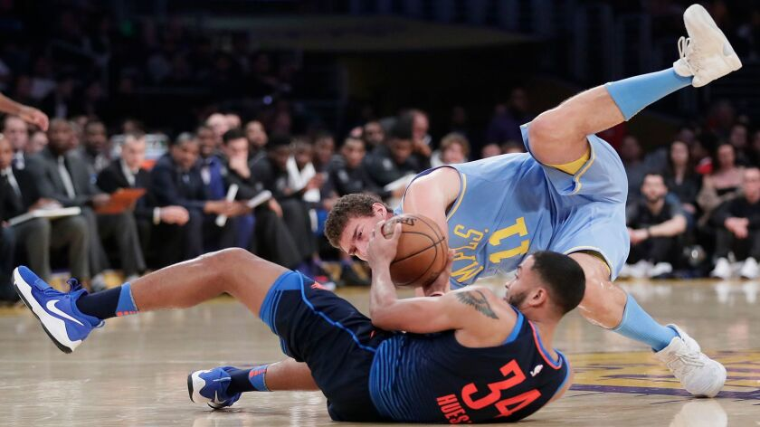 Lakers center Brook Lopez tumbles over Oklahoma City guard Josh Huestis in pursuit of a loose ball on Jan. 3.