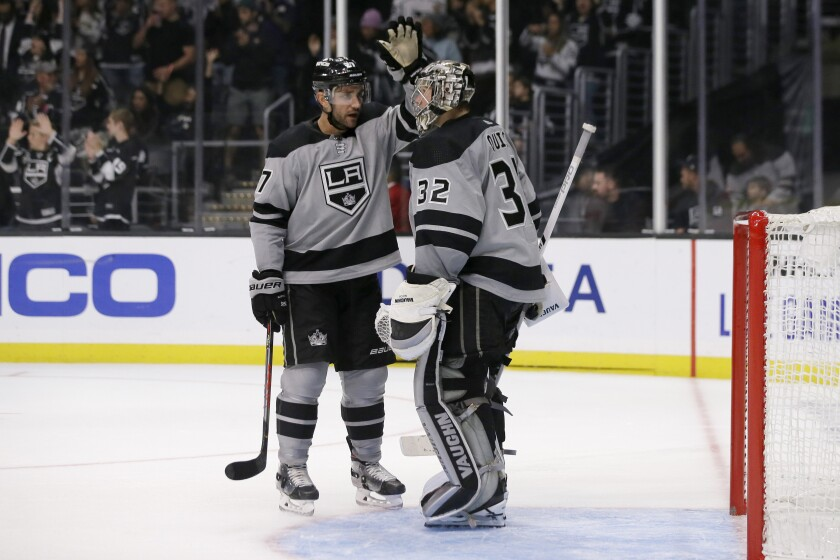 Kings defenseman Alec Martinez congratulates goaltender Jonathan Quick after the team's 4-1 win Oct. 19, 2019.