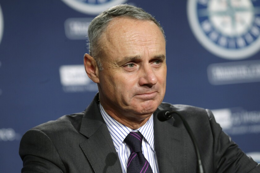 MLB Commissioner Rob Manfred talks to reporters before Wednesday's Angels/Mariners game in Seattle.