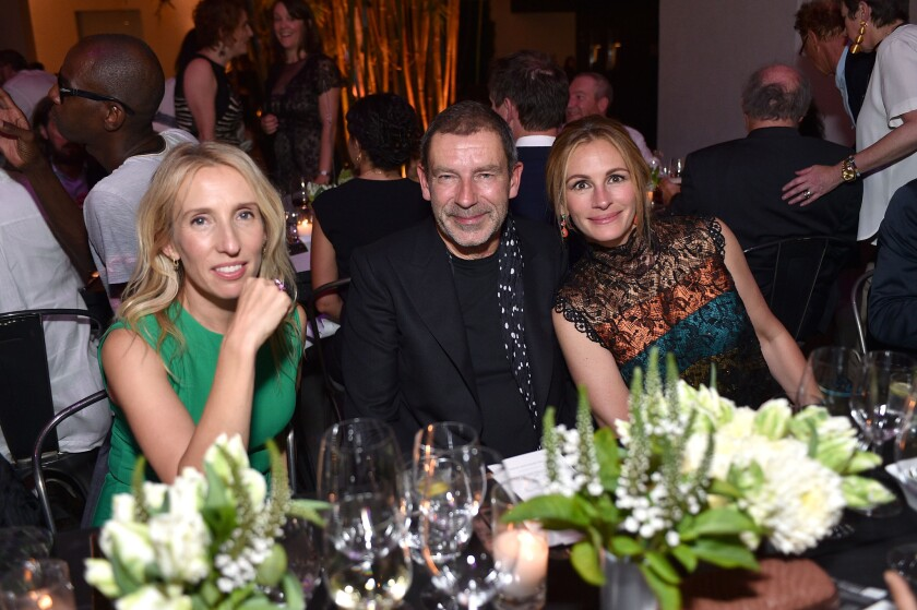 From left, Sam Taylor-Johnson (in Bottega Veneta), Bottega Veneta creative director Tomas Maier and Julia Roberts (also in Bottega Veneta), attend Hammer Museum's Gala in the Garden sponsored by the Italian luxury brand on Oct. 10, 2015.