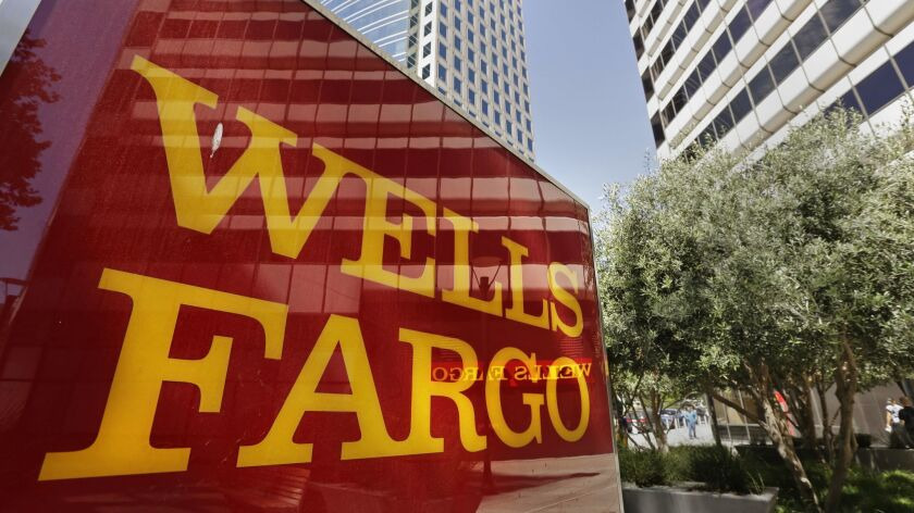 Wells Fargo's interim CEO is interrupted by hecklers at