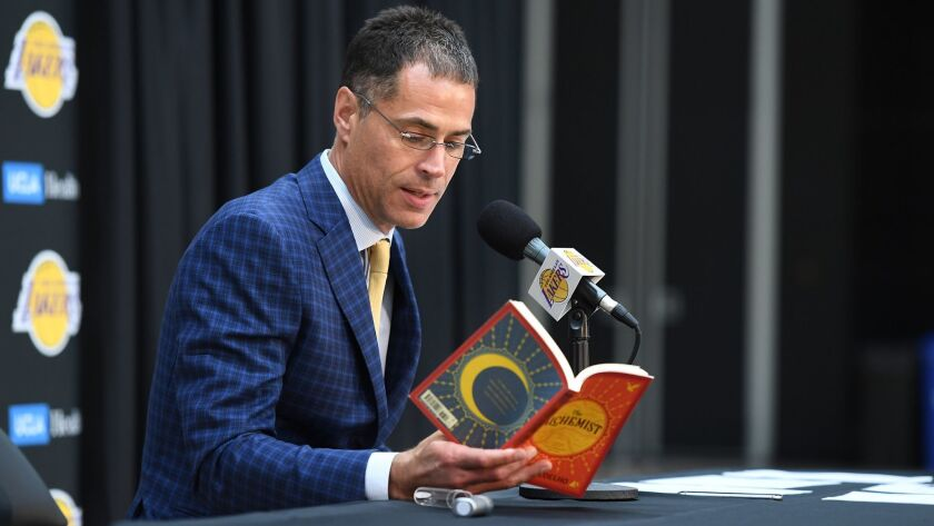 "Lakers general manager Rob Pelinka reads a quote from ""The Alchemist"" during a news conference Wednesday in El Segundo."
