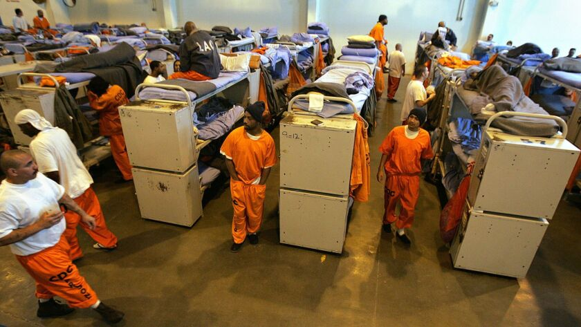 """In a photograph from 2007, inmate beds fill a gymnasium converted into a temporary """"emergency"""" sleeping area at California State Prison, Los Angeles County in Lancaster. This kind of state prison overcrowding is now a thing of the past."""