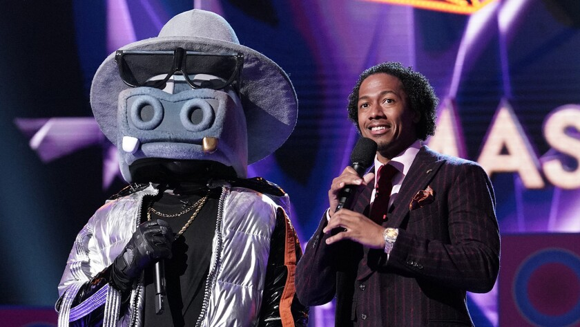 "Nick Cannon, right, hosts ""The Masked Singer"" on Fox."