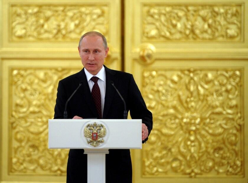 Russian President Vladimir Putin speaks at the Kremlin in Moscow.