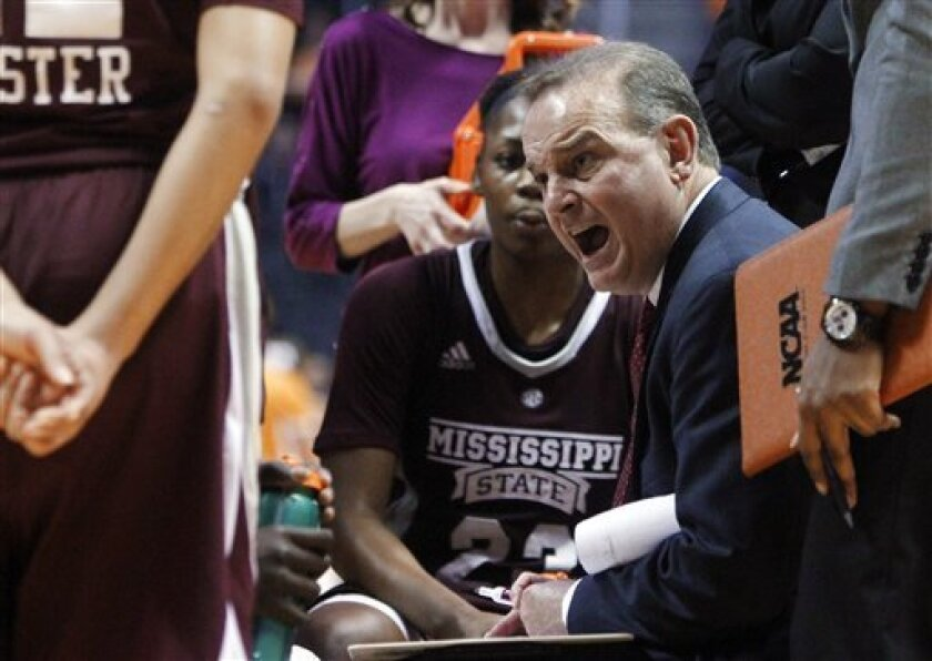 Mississippi State coach Vic Schaefer yells to his players during a timeout in the second half of an NCAA college basketball game against Mississippi State on Thursday, Jan. 31, 2013, in Knoxville, Tenn. Tennessee won 88-45. (AP Photo/Wade Payne)