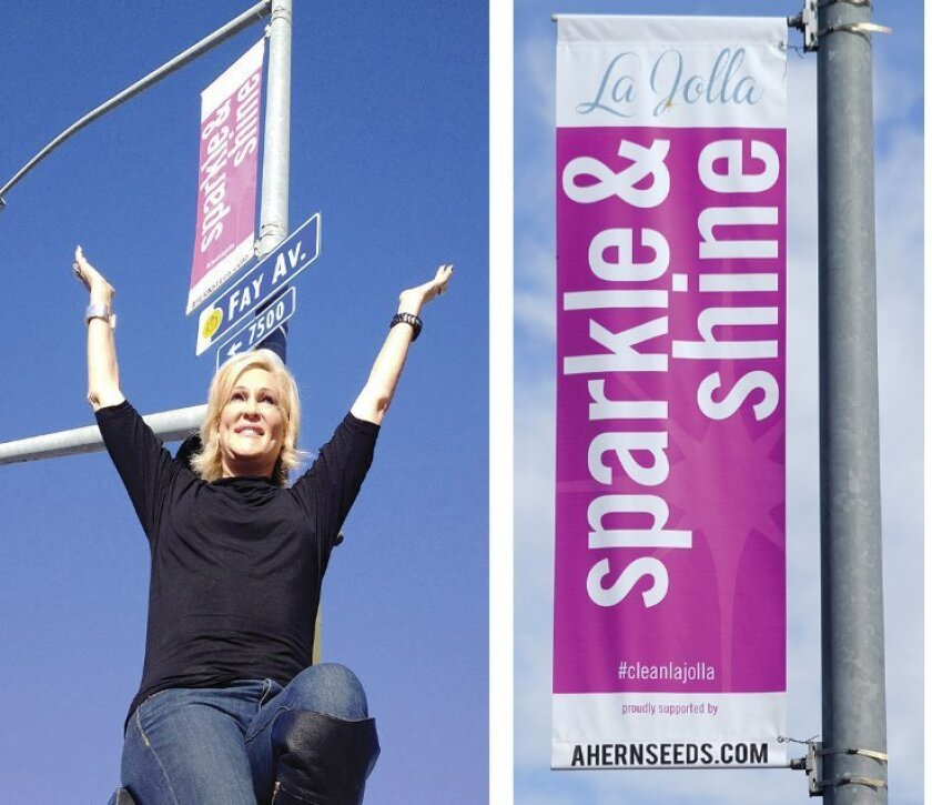 Community leader and La Jolla Art & Wine Festival founder Sherry Ahern poses beneath the banner she and her family purchased at the corner of Fay Avenue and Pearl Street. Ahern has also assisted Sparkle & Shine organizer Nancy Warwick in recruiting donors to the campaign.