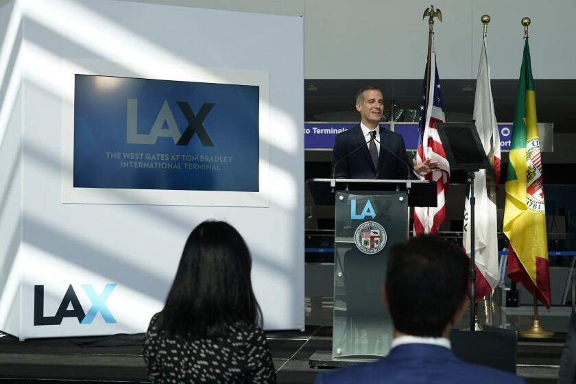Los Angeles Mayor Eric Garcetti at a podium