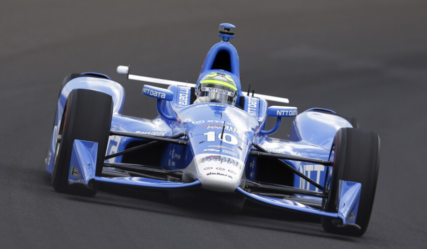 Tony Kanaan drives the first turn during a practice session at Indianapolis Motor Speedway on May 21, the opening day of qualifications for the Indianapolis 500.