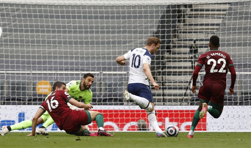 Tottenham's Harry Kane, center, scores the opening goal during the English Premier League soccer match between Tottenham Hotspur and Wolverhampton Wanderers at Tottenham Hotspur Stadium in London, England, Sunday, May 16, 2021. (AP Photo/Adrian Dennis, Pool)