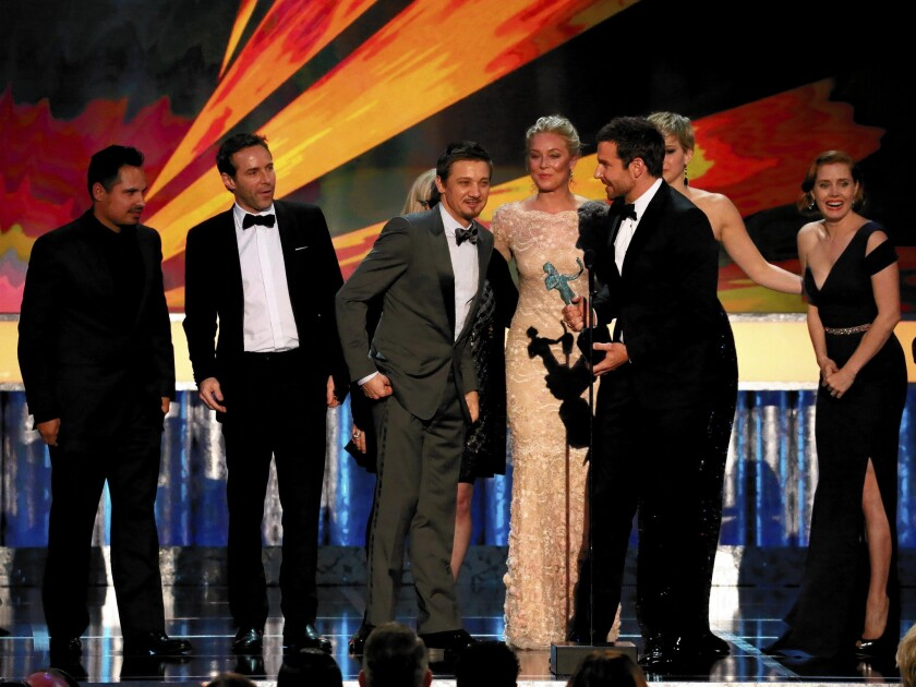 """The jubiliant stars of David O. Russell's """"American Hustle"""" take to the stage to accept the cast award, a significant recognition in the lead-up to the Oscars."""