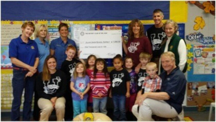 Del Mar Rotarians (from left): Donna Fipps, Susan Wagner, Janice Kurth and pictured on the right, Peggy Martin and Marty Peters, present the $1,000 grant funding to Julian Elementary School Kindergarten Class led by Tere Tangeman and Carol Kurth, joined by Kevin Ogden, superintendent for the Julian