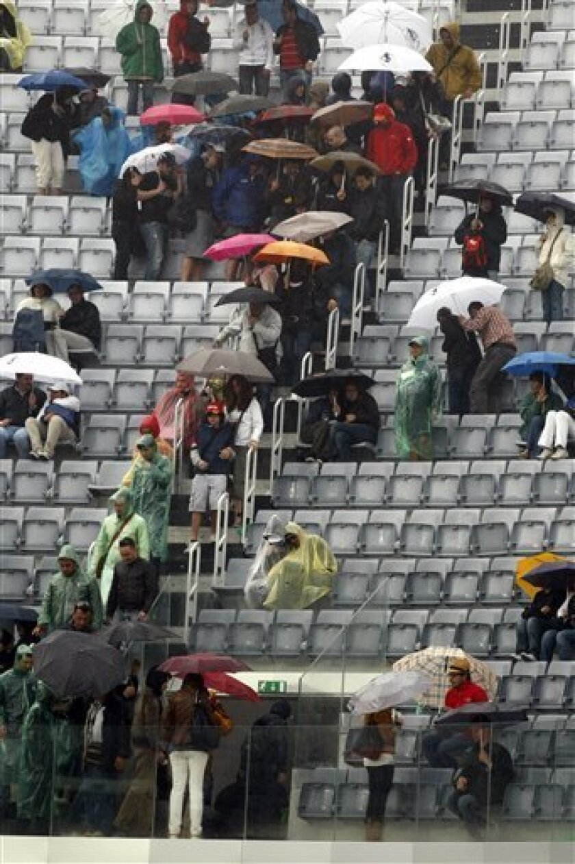 People walk off the stadium during the final match between Spain's David Ferrer and Rafael Nadal, at the Rome Masters tennis tournament in Rome, Sunday, May 2, 2010. The match was suspended due to rain. (AP Photo/Pier Paolo Cito)