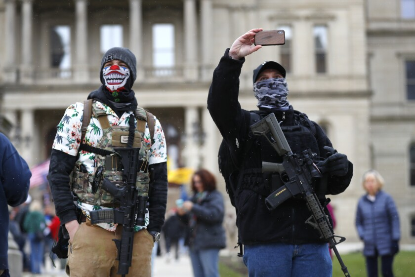 Protesters gathered Wednesday outside the Michigan state Capitol to express displeasure with Gov. Gretchen Whitmer's orders to keep people at home and businesses closed during the coronavirus crisis.