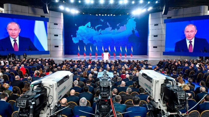 Russian President Vladimir Putin delivers his annual State of the Nation address in Moscow on Feb. 20.