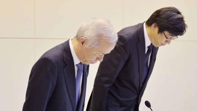 Tokyo Electric Power Co. President Naomi Hirose, left, and senior director Takafumi Anegawa bow during a news conference at the TEPCO headquarters in Tokyo on Tuesday, June 21, 2016.