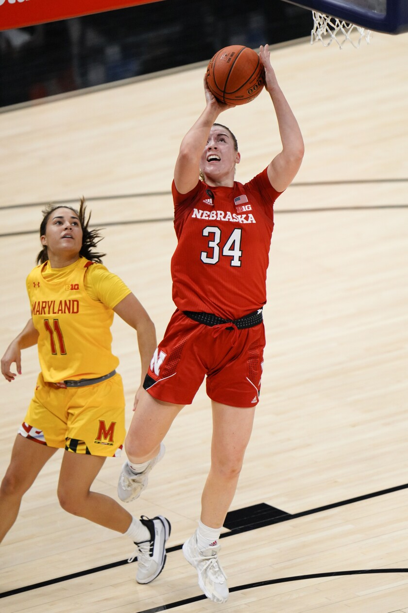 Nebraska forward Isabelle Bourne (34) shoots in front of Maryland guard Katie Benzan (11) in the second half of an NCAA college basketball game in the quarterfinals of the Big Ten Conference tournament in Indianapolis, Thursday, March 11, 2021. Maryland won 83-73. (AP Photo/AJ Mast)
