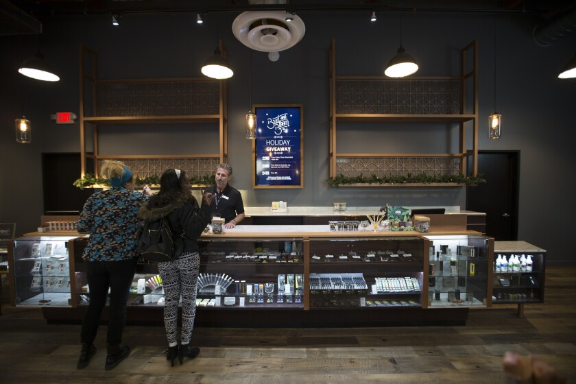 Patrons shop at Bud and Bloom, a Santa Ana marijuana dispensary.