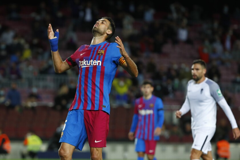Barcelona's Sergio Busquets reacts after missing an opportunity to score during the Spanish La Liga soccer match between Barcelona and Granada, at the Camp Nou stadium in Barcelona, Spain, Monday, Sept. 20, 2021. (AP Photo/Joan Monfort)