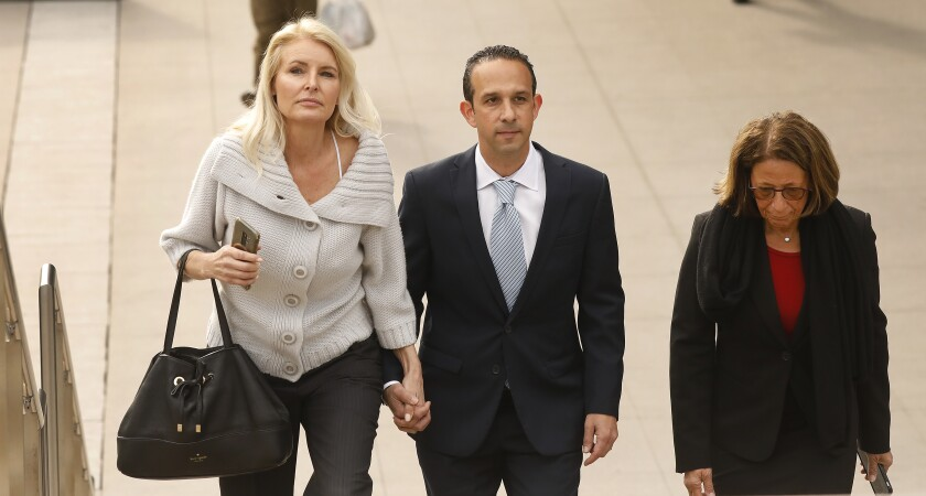 Mitchell Englander with his wife Jayne Englander and lead attorney Janet Levine.
