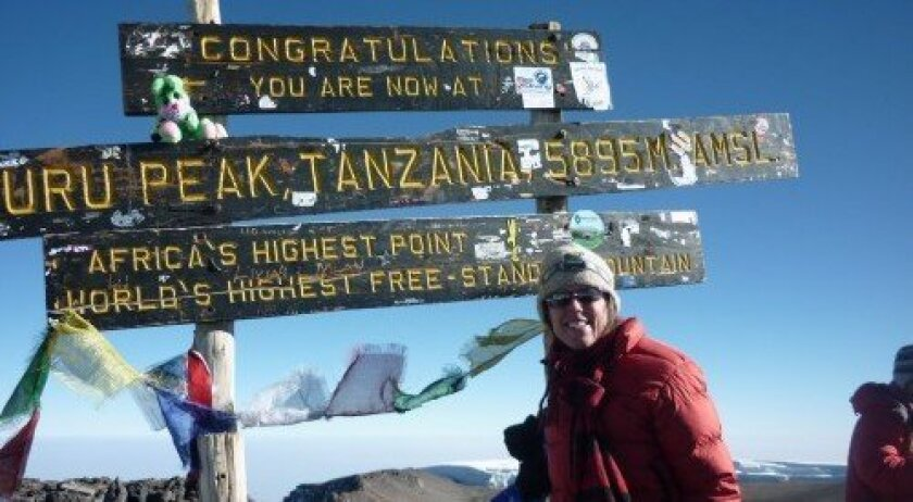 Janice Coy at the top of the Kibo summit of Mount Kilimanjaro (Courtesy photo)