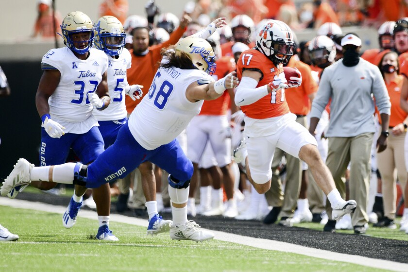 Tulsa linebacker Deven Lamp (58) forces Oklahoma State receiver Dillon Stoner (17) out of bounds on Sept 19, 2020.