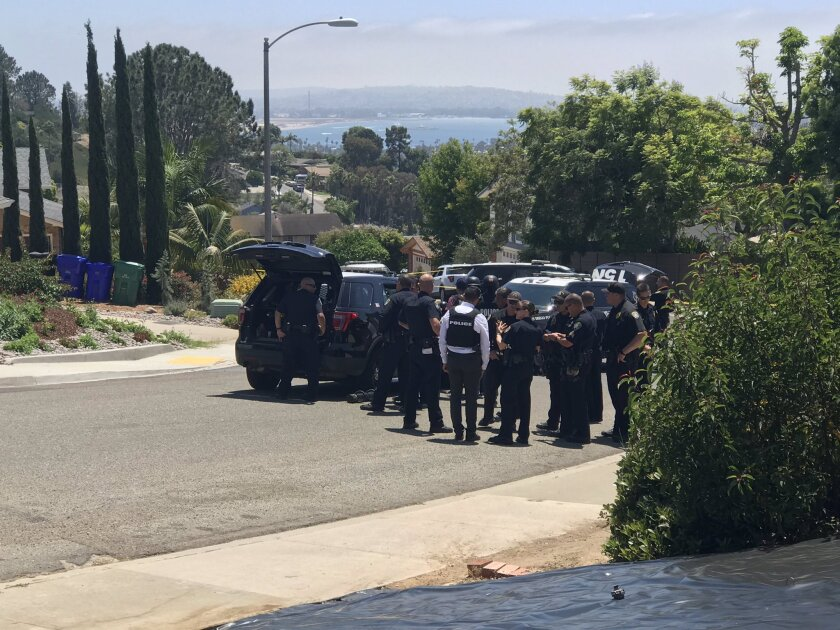 San Diego police officers on Thursday gathered outside a home where a man wanted on a warrant holed up for more than six hours.