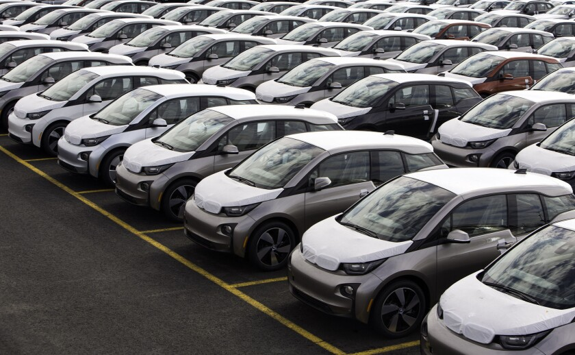 California vehicle emissions dropped from 2011 to 2012, in part because of increased adoption of electric and hybrid cars, like these new, fully electric BMW i3's arriving at the company's Port Jersey Vehicle Distribution Center in Jersey City, New Jersey.