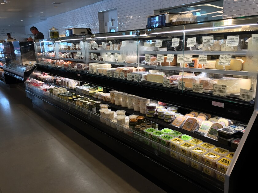 Gourmet cheeses, deli meats and prepared foods in the deli case at The Butchery in Del Mar's One Paseo center.