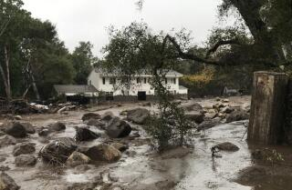River rages through yard of Montecito home